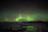 Northern Lights (Aurora Borealis) over Jökulsárlón Glacial Lagoon, Southeast Iceland.
