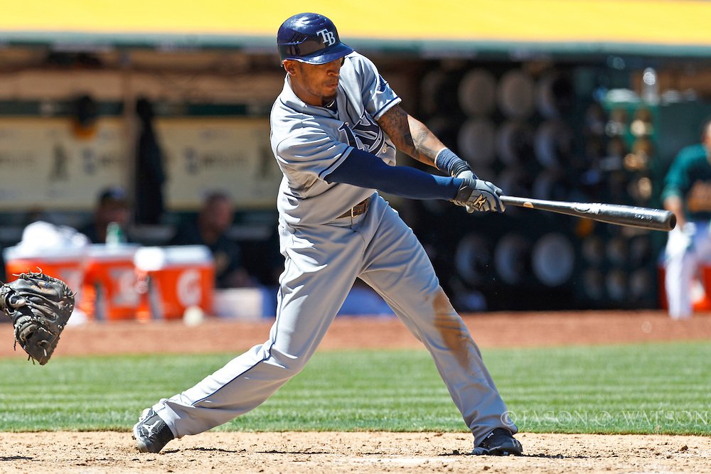 OAKLAND, CA - AUGUST 01: Desmond Jennings #8 of the Tampa Bay Rays hits a double against the Oakland Athletics during the ninth inning at O.co Coliseum on August 1, 2012 in Oakland, California. The Tampa Bay Rays defeated the Oakland Athletics 4-1. (Photo by Jason O. Watson/Getty Images) *** Local Caption *** Desmond Jennings