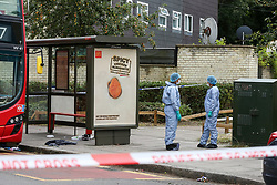 © Licensed to London News Pictures. 11/08/2019. London, UK. Forensic officers on the Seven Sisters Road junction with St Ann's Road in Tottenham, north London, where a 25 year old man was found with multiple stab wounds on Bus 67 at the Seven Sister Road/Kerswell Close bus stop, just before 2.20pm. According to the Met police, the victim is fighting for his life in hospital. Photo credit: Dinendra Haria/LNP