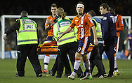 Picture by David Horn/Focus Images Ltd +44 7545 970036.05/01/2013.JJ O'Donnell of Luton Town is carried off on a stretcher after a blow to the head as team mates Janos Kovacs (rear), Jon Shaw (front) and Arnaud Mendy (right) look on during the The FA Cup match at Kenilworth Road, Luton.