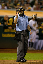 OAKLAND, CA - SEPTEMBER 23:  MLB umpire Chris Guccione #68 calls a strike during the ninth inning between the Oakland Athletics and the Los Angeles Angels of Anaheim at O.co Coliseum on September 23, 2014 in Oakland, California. The Los Angeles Angels of Anaheim defeated the Oakland Athletics 2-0.  (Photo by Jason O. Watson/Getty Images) *** Local Caption *** Chris Guccione
