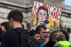 London, UK. 16 October, 2019. A sign featuring an image of Greta Thunberg among hundreds of climate activists from Extinction Rebellion defying the Metropolitan Police prohibition on Extinction Rebellion Autumn Uprising protests throughout London under Section 14 of the Public Order Act 1986 by attending a Right to Protest assembly in Trafalgar Square.