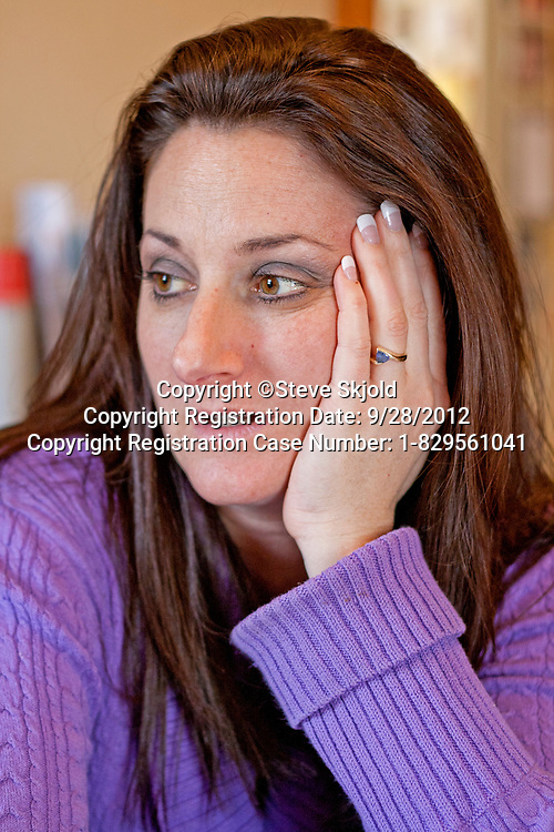 Portrait of a good looking thoughtful woman age 41 at home. St Paul Minnesota MN USA