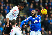 Crewe Alexandra defender Semi Ajayi and Chesterfield FC forward Sylvan Ebanks-Blake challenge for the ball in the air during the Sky Bet League 1 match between Chesterfield and Crewe Alexandra at the Proact stadium, Chesterfield, England on 20 February 2016. Photo by Aaron Lupton.