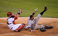 epa01922352 YEARENDER 2009 OCTOBER    New York Yankee Alex Rodriguez (R) slides safely into home as Los Angeles Angels catcher Mike Napoli shows the ball during game four of the American League Championship Series in the 4th inning at Angel Stadium in Anaheim, California, USA 20 October 2009. The winner of the seven game series will advance to the World Series.  EPA/ANDREW GOMBERT