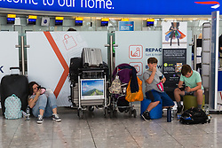 Passengers await news of their flights at Terminal 5 at Heathrow Airport after an IT glitch brings British Airways systems to a halt, causing disruption to thousands of passengers with flights cancelled and delayed. London, August 07 2019.