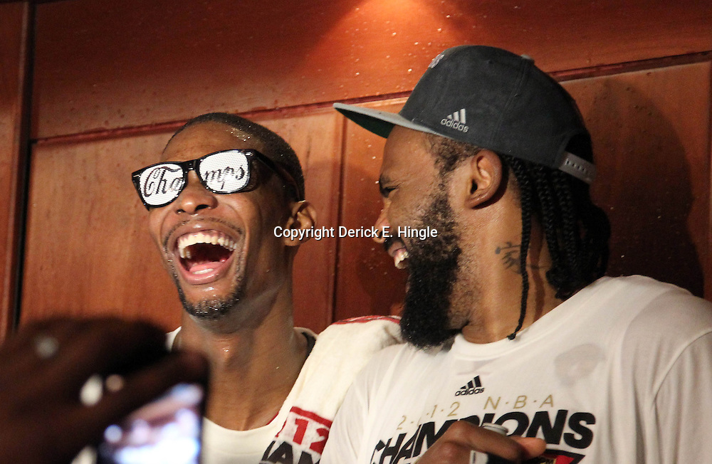 Jun 21, 2012; Miami, FL, USA; Miami Heat power forward Chris Bosh (left) and center Ronny Turiaf (right) celebrate in the locker room after winning the 2012 NBA championship at the American Airlines Arena. Miami won 121-106. Mandatory Credit: Derick E. Hingle-USA TODAY SPORTS