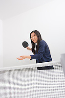 Beautiful young woman preparing to serve ping pong ball