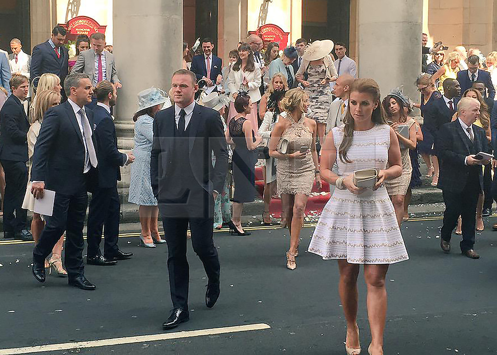 © Licensed to London News Pictures. 16/06/2015. London, UK. Wayne and Coleen Rooney leave after attending what is believed to be the wedding of Manchester United footballer Tom Cleverly and his fiancé Georgina Dorsett Photo credit : Alfonso Camacho/LNP
