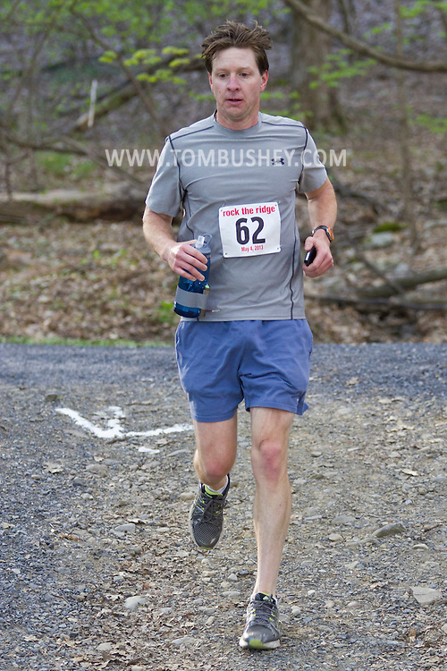 Gardiner, New York - Paul Mullen competes in the Rock the Ridge 50-mile endurance challenge race at the Mohonk Preserve on May 4, 2013. The race is part of Mohonk's 50th anniversary celebration and a fundraiser for the preserve.