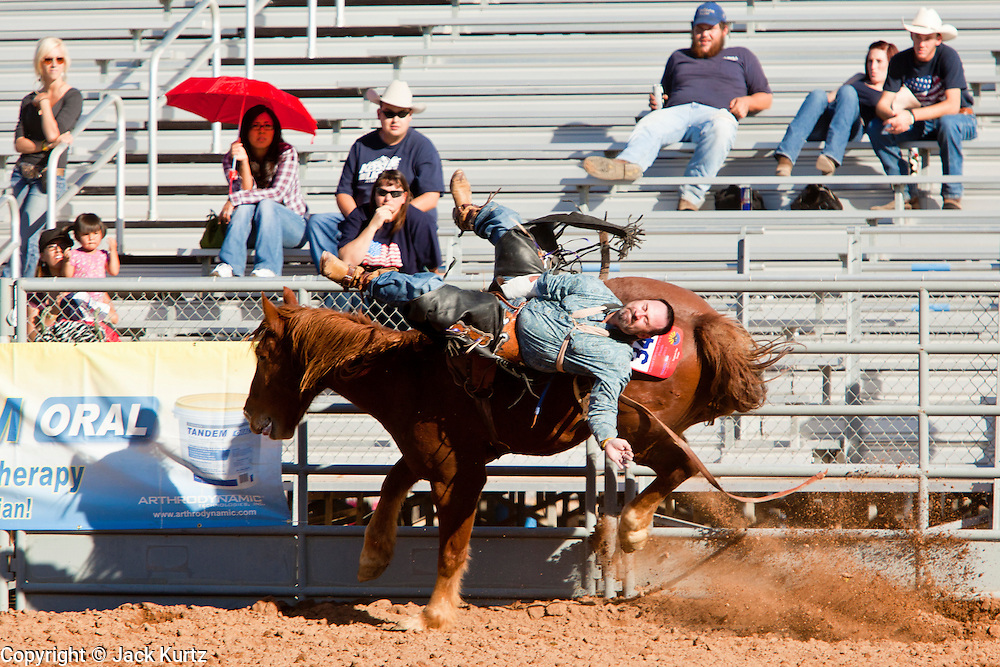 26 NOVEMBER 2011 - CHANDLER, AZ:    ADAM TANNER competes in the bareback bronc riding competition at the Grand Canyon Pro Rodeo Association (GCPRA) Finals at Rawhide Western Town in west Chandler, AZ, about 20 miles from Phoenix Saturday. The GCPRA Finals is the last rodeo of the GCPRA season. The GCPRA is a professional rodeo association based in Arizona.     Photo by Jack Kurtz / ZUMA PressPHOTO BY JACK KURTZ