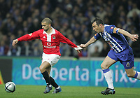 """PORTUGAL - PORTO 28 FEBRUARY 2005: SIMAO SABROSA #20(L) is pulled by JORGE COSTA #2, in the 23 leg of the Portuguese soccer league """"Super Liga"""" FC Porto (1) vs SL Benfica (1), held in """"Dragao"""" stadium  28/02/2005  19:55:54<br />(PHOTO BY: NUNO ALEGRIA/AFCD)<br /><br />PORTUGAL OUT, PARTNER COUNTRY ONLY, ARCHIVE OUT, EDITORIAL USE ONLY, CREDIT LINE IS MANDATORY AFCD-PHOTO AGENCY 2004 © ALL RIGHTS RESERVED"""