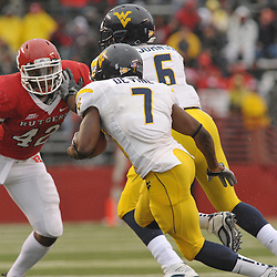 Dec 5, 2009; Piscataway, NJ, USA; West Virginia running back Noel Devine (7) runs past a block by fullback Will Johnson (6) on Rutgers linebacker Steve Beauharnais (42) during first half NCAA Big East college football action between Rutgers and West Virginia at Rutgers Stadium.