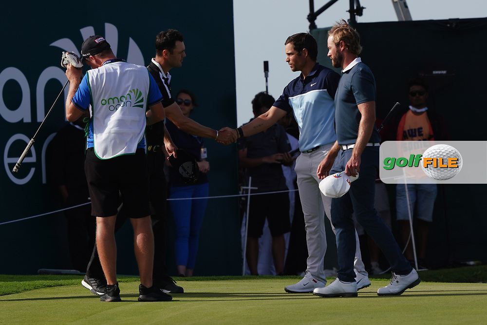 Martin Kaymer (GER), Adrien Saddier (FRA) and Kalle Samooja (FIN) on the 18th during Round 4 of the Oman Open 2020 at the Al Mouj Golf Club, Muscat, Oman . 01/03/2020<br /> Picture: Golffile   Thos Caffrey<br /> <br /> <br /> All photo usage must carry mandatory copyright credit (© Golffile   Thos Caffrey)