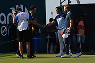 Martin Kaymer (GER), Adrien Saddier (FRA) and Kalle Samooja (FIN) on the 18th during Round 4 of the Oman Open 2020 at the Al Mouj Golf Club, Muscat, Oman . 01/03/2020<br /> Picture: Golffile | Thos Caffrey<br /> <br /> <br /> All photo usage must carry mandatory copyright credit (© Golffile | Thos Caffrey)