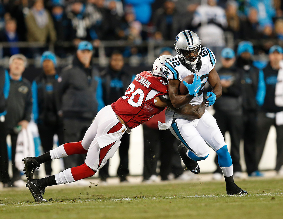 CHARLOTTE, NC - JAN 24:  Wide receiver Jericho Cotchery #82 of the Carolina Panthers is wrapped up by safety Deone Bucannon #20 of the Arizona Cardinals during the NFC Championship game at Bank of America Stadium on January 24, 2016 in Charlotte, North Carolina.