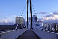 DEU, Germany, Duesseldorf, bridge and the Neue Zollhof at the river Rhine harbour, architect Frank O´Gehry.....DEU, Deutschland, Duesseldorf, Bruecke und der Neue Zollhof im Rheinhafen, Gebaeude des Architekten Frank O.Gehry.........