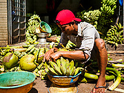 18 NOVEMBER 2017 - YANGON, MYANMAR: A workers puts together offering baskets of bananas and a coconut at Botataung Pagoda in Yangon. Pope Francis is visiting Myanmar, September 27-30. It will be the first visit by a Pope to the overwhelmingly Buddhist nation. He will meet with the Aung San Suu Kyi and other political leaders and will participate in two masses in Yangon. The Pope is expected to talk about Rohingya issue while he is in Myanmar. The Rohingya are persecuted Muslim minority in Rakhine state in western Myanmar. It's not clear how Myanmar's politically powerful nationalist monks will react if the Pope openly talks about the Rohingya. In the past, the monks have led marches and demonstrations against foreign diplomatic missions when foreign ambassadors have spoken in defense of the Rohingya. There is not much visible sign of the Pope's imminent visit in Yangon, which is estimated to be more than 90% Buddhist.     PHOTO BY JACK KURTZ