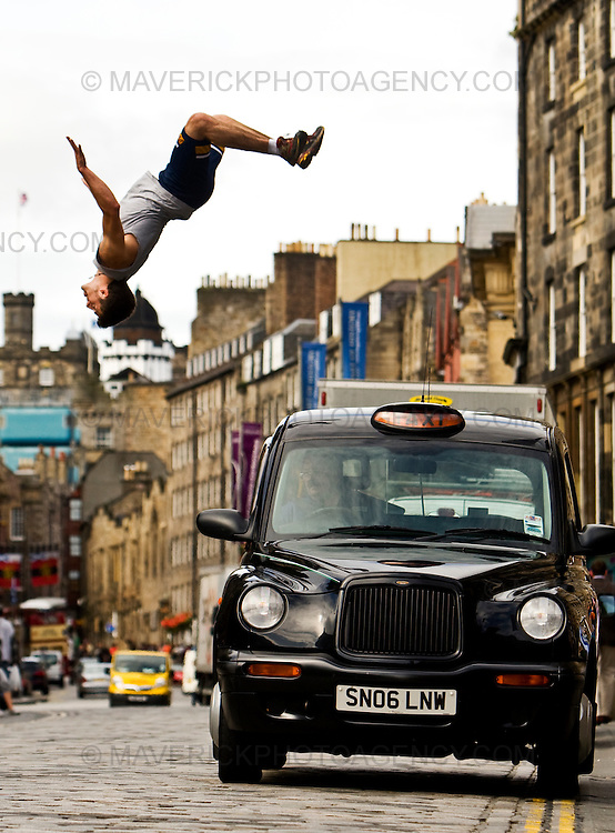 """..John Hall leaps over a taxi on Edinburg's Royal Mile to launch the new """"Urbathon"""" event to be held in Scotlands capital...HUNDREDS of runners will have the chance to jump, climb and crawl their way through the capital in the first  10 kilometre race of its kind to take place in Scotland which involves obstacle course challenges. ..Picture Michael Hughes/Maverick"""
