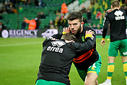 Norwich City defender Grant Hanley (31) warming up before the The FA Cup 3rd round match between Norwich City and Portsmouth at Carrow Road, Norwich, England on 5 January 2019.