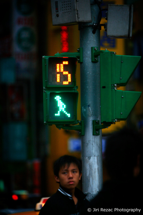TAIWAN TAIPEI 4NOV07 - A pedestrian stands underneath an animated green light at a major zebra crossing near Taipei Main Station, Taiwan...jre/Photo by Jiri Rezac..© Jiri Rezac 2007..Contact: +44 (0) 7050 110 417.Mobile:  +44 (0) 7801 337 683.Office:  +44 (0) 20 8968 9635..Email:   jiri@jirirezac.com.Web:    www.jirirezac.com..© All images Jiri Rezac 2007 - All rights reserved.