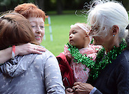 FALLSINGTON, PA -  SEPTEMBER 14:  Eileen Zettick (2 from left) greets Gwen Fennessy (left), Ava Brantley, 5 months old, and Cookie Fennessy, of Bristol, Pennsylvania at the Irish Festival September 14, 2013 in Fallsington, Pennsylvania. (Photo by William Thomas Cain/Cain Images)