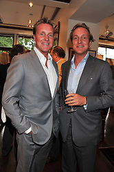 Left to right, brothers HENRY BECKWITH and PIERS BECKWITH at a party to celebrate the launch of the new Mauritius Collection of jewellery by Forbes Mavros held at Patrick Mavros, 104-106 Fulham Road, London SW3 on 5th July 2011.