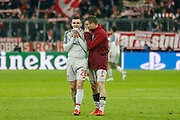 Liverpool midfielder James Milner (7) and Liverpool defender Andrew Robertson (26) after Liverpool's win during the Champions League match between Bayern Munich and Liverpool at the Allianz Arena, Munich, Germany, on 13 March 2019.