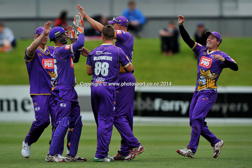 The Canterbury Wizards celebrate the wicket of Sam Wells of the Otago Volts, during the Georgie Pie Twenty20 match between the Otago Volts and the Canterbury Kings, held at the University Oval, Dunedin, New Zealand, 20 November 2014. Credit: Joe Allison / www.photosport.co.nz