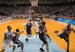 University of North Carolina's Ty Lawson (5) shoots over Virginia's Jason Cain (33).  The #1 ranked Tar Heels beat the Cavaliers 79-69 to improved to 15-1 overall, 2-0 ACC on January 10, 2007 at the Dean Smith Center in Chapel Hill, NC.<br />