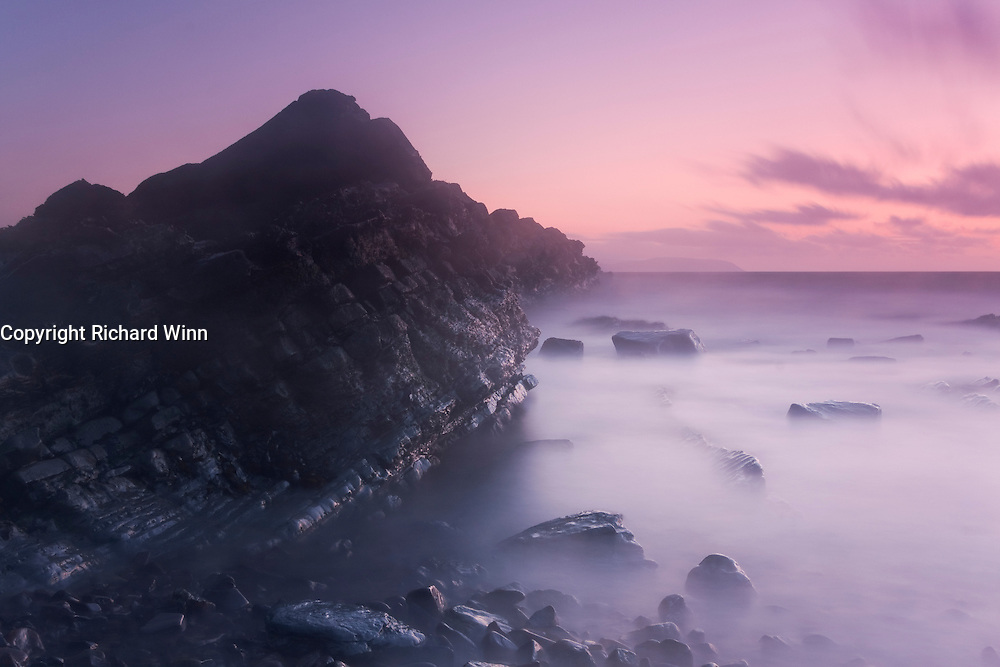 Long exposure of over one minute after sunset at Kilve Beach on the north Somerset coast, turning the waves to mist.