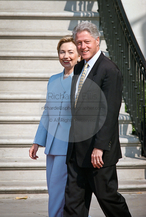 President Bill Clinton and first lady Hillary Rodham Clinton smile as they wait for the arrival of the Hungarian President Arpad Goncz at the White House June 8, 1999. Earlier President Clinton said he is looking forward to being the husband of a senator, fueling speculation that first lady Hillary Rodham Clinton is inching closer to a run for the Senate.