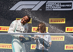 June 9, 2019 - Quebec, Canada - Race winner LEWIS HAMILTON of Great Britain and Mercedes GP gets a champagne shower on podium during the F1 Grand Prix of Canada at Circuit Gilles Villeneuve on June 9, 2019 in Montreal, Canada. (Credit Image: © Andrew Chin/ZUMA Wire)