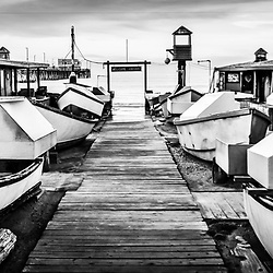 Newport Beach Dory Fishing Fleet panorama photo in black and white. Dory Fishing Fleet is a historic landmark in Newport Beach California on Balboa Peninsula in Orange County. Panoramic photo ratio is 1:3.