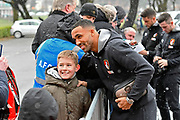 Callum Wilson (13) of AFC Bournemouth has a photo with a young fan as he arrives at the Vitality Stadium with light snow falling before the Premier League match between Bournemouth and West Bromwich Albion at the Vitality Stadium, Bournemouth, England on 17 March 2018. Picture by Graham Hunt.