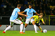 Southend United's Timothée Dieng (8) holds off Burton Albion midfielder Jamie Allen (4) during the EFL Sky Bet League 1 match between Burton Albion and Southend United at the Pirelli Stadium, Burton upon Trent, England on 2 October 2018.