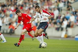 OSLO, NORWAY - Thursday, May 27, 2004:  Wales' John Oster and Norway's Magne Hoset during the International Friendly match at the Ullevaal Stadium, Oslo, Norway. (Photo by David Rawcliffe/Propaganda)
