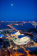 Aerial of the Grand Opening of the Carnival Center for Performing Arts located in downtown Miami, with the full moon rising over Miami Beach and the ocean in the distance.