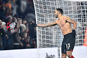 Callum Wilson (13) of AFC Bournemouth throws his shirt in to the crowd as he celebrates the 3-1 win at full time during the Premier League match between Bournemouth and Brighton and Hove Albion at the Vitality Stadium, Bournemouth, England on 21 January 2020.