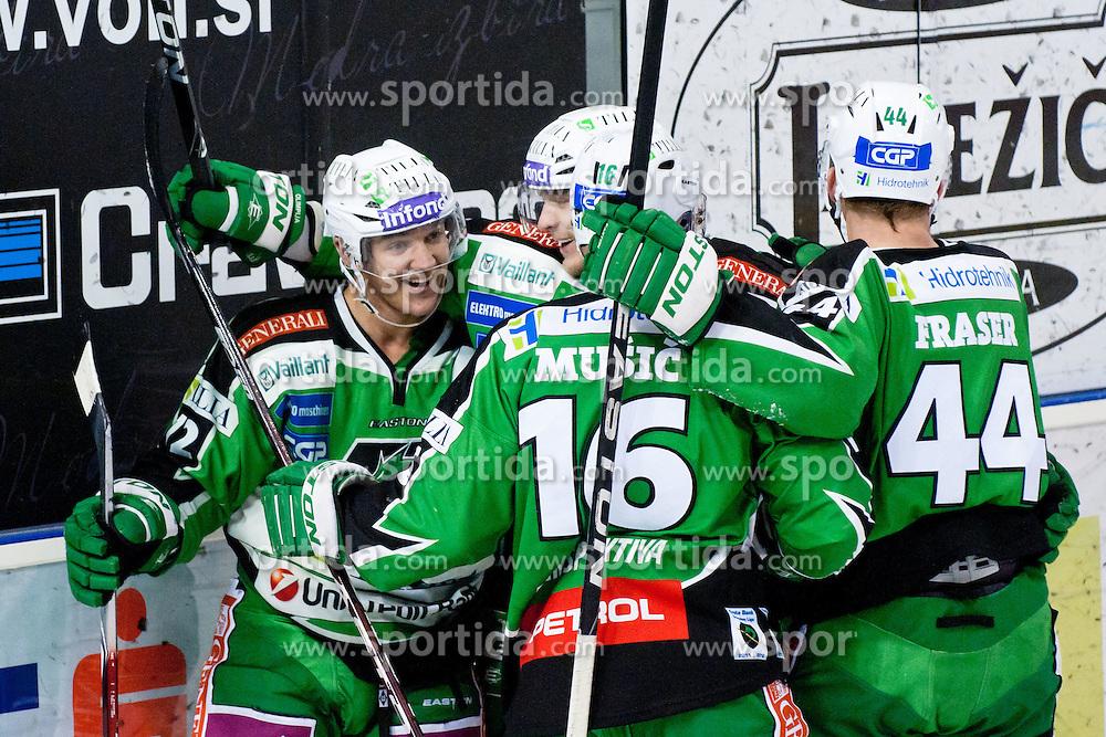 Team HDD Tilia Olimpija celebrate goal during ice-hockey match between HDD Tilia Olimpija and HC Znojmo Orli in 24th Round of EBEL league, on November 22, 2011 at Hala Tivoli, Ljubljana, Slovenia. (Photo By Matic Klansek Velej / Sportida)