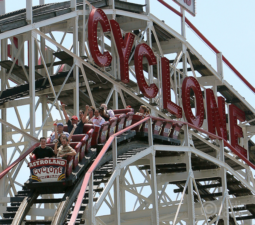 Passengers are seen on the Cyclone roller coater during the 80th anniversary celebration of the famous ride's first run in the Coney Island area of Brooklyn, New York on 26 June 2007.