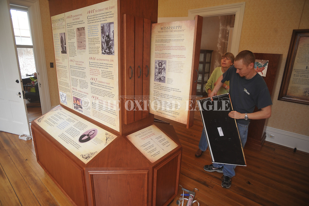 Robert Smith of  Malone Design/Fabrication installs an exhibit at the L.Q.C. Lamar House in Oxford, Miss. on Wednesday, March 9, 2011.