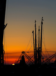 shrimp boat lines in the sky at sunset