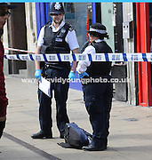 Police guard a bag of money - Immediate aftermath of armed raid on Post Office in George Street, Coydon<br /> <br />  - &copy; David Young - www.davidyoungphoto.co.uk - email: davidyoungphoto@gmail.com