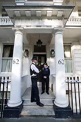 © London News Pictures. 10/07/2012. London, UK. Police guard the entrance to a property on Cadogan Place in Belgravia, West London today (10/07/2012) where the body of Tetra Pak heir EVA RAUSING was found yesterday. The Hans Kristian Rausing the Husband of EVA RAUSING has been arrested in connection with the death and is being questioned by police. Photo credit: Ben Cawthra/LNP.
