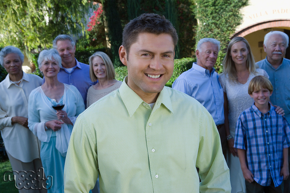 Mid-adult man celebrating with family in garden