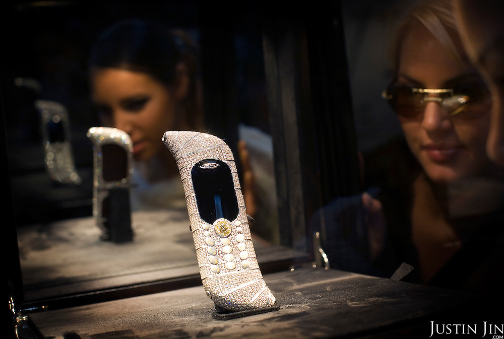 Woman look at a one-million-dollar mobile phone, made by Goldvish of Geneva, at the Millionaire Fair in Moscow. .Millionaires, billionaires and those who bought 1,000-rouble tickets were among the thousands who visited the fair held in the Crocus city expo centre. .The four-day event, held for the second year in a row, ended on October 30. The products on sale include a diamond-studded mobile phone worth a million dollars, an island, latest sports cars and other items that might appeal to the growing millionaire market..Twenty years ago, there were no official millionaires in the whole of Russia. Now Moscow has 25 billionaires and the country has 88,000 millionaires, according to Forbes Magazine. ..