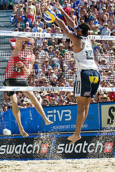 Matt Fuerbringer of USA strikes and Ricardo Costa Santos of Brazil tries to block the shot at A1 Beach Volleyball Grand Slam tournament of Swatch FIVB World Tour 2010, semifinal, on August 1, 2010 in Klagenfurt, Austria. (Photo by Matic Klansek Velej / Sportida)