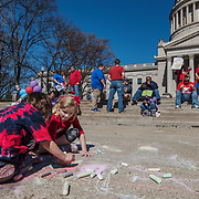 Colette Brown (back turned), 6, and Emily Knight, 6, draw with chalk on the sidewalk as their mothers who are also teachers from Nitro demonstrate (out of frame) outside of the capitol building on the fourth day of statewide walkouts in Charleston, W.V., on Tuesday, February 27, 2018.