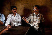 Village Child Protection Committee (VCPC) members (L-R) Durga Prasad Bhatarai (46), and Harsha Bahadur Pun (63) speak of their work and the issues of child marriage  in Lekhapharsa vilage, Surkhet district, Western Nepal, on 30th June 2012. The VCPC works to intervene in child marriages such as the case of Pramila and is supported by Save the Children and local NGO Safer Societies. In Surkhet, StC partners with Safer Society, a local NGO which advocates for child rights and against child marriage. Photo by Suzanne Lee for Save The Children UK